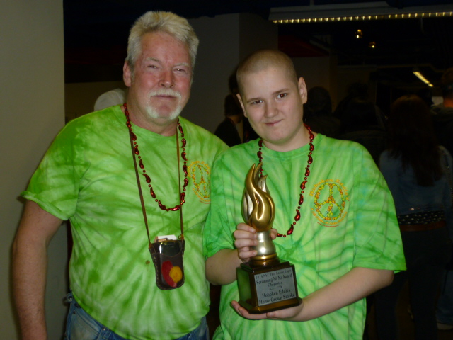Hoboken Eddie and Eddie Jr show off their Screaming Mi Mi Award