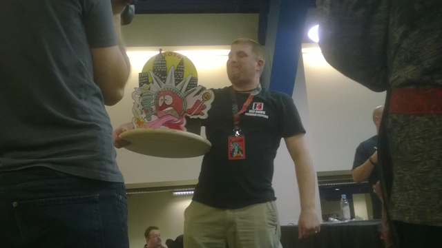 Dan Lowenstein shows off his Lick-a-Thon Trophy