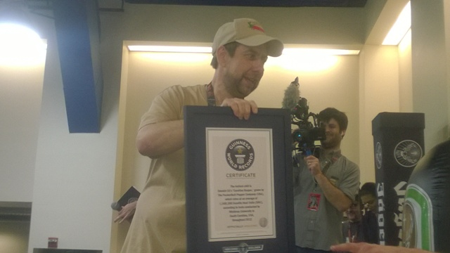 Ed Currie of Puckerbutt shows off the Guinness Plaque